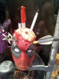 deadpool with pens in head