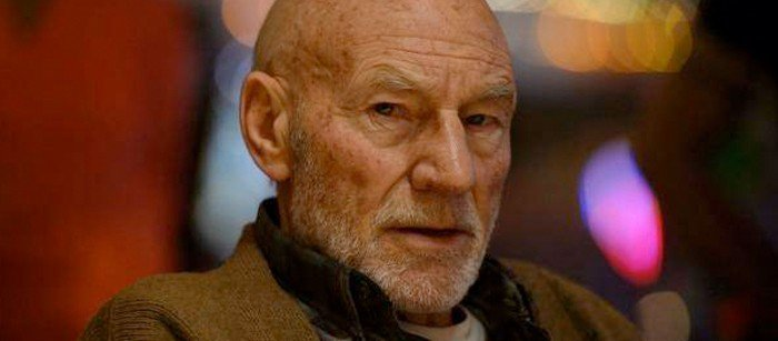 A close up of Patrick Stewart in the film Logan. he is looking a bit older, wizened.