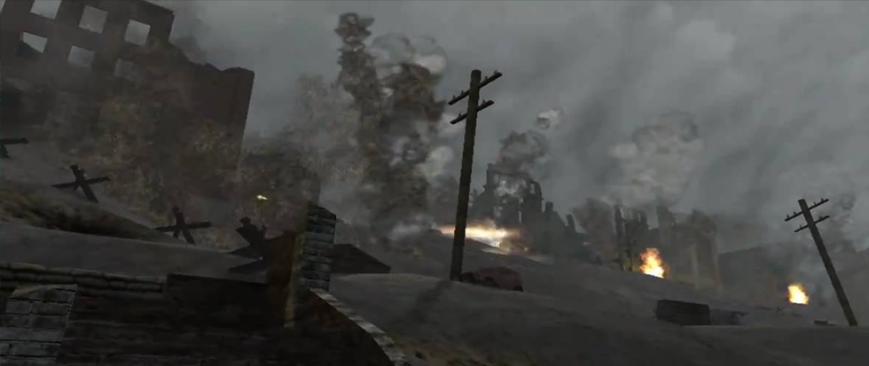 A smoky, pixelated background with several power lines in the distance. This is a still from Call of Duty 1