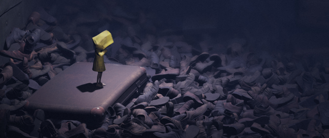 A small child in a yellow rain coat stands on a piece of luggage amid a sea of shoes. This is a still from the game Little Nightmares.