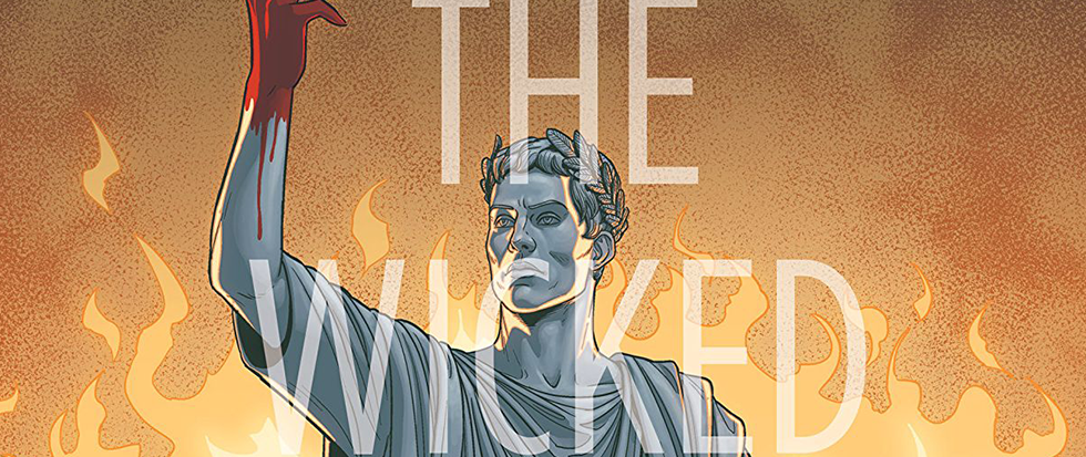 "Cover art from the Wicked and Divine issue. A figure, dressed in toga and laurel crown is lit in a sort of blue with a uplifted hand covered in blood. Behind the figure it looks like there are orange flames rising, and in front of him is the text, slightly opaque that reads ""The Wicked"""