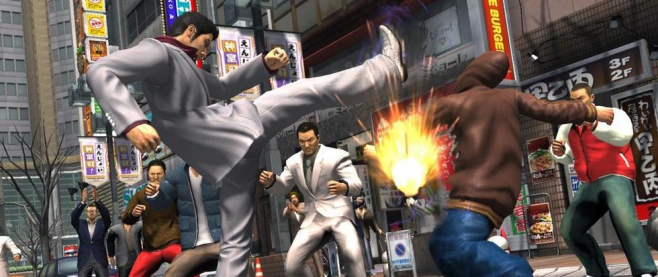 A man in a white suit is kicking another man in a brown bomber jacket in front of a crowd of people. This is a still from the game Yakuza