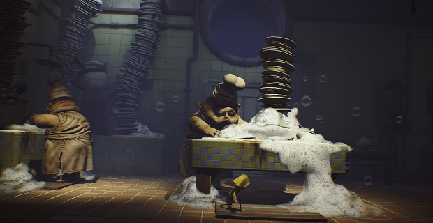 A small child in a yellow ranicoat runs under a washtub overflowing with dirty dishes and soap. a grotesque man in a chefs hat washes dishes behind the counter. This is a still from the game Little Nightmares