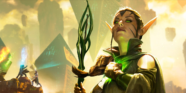 An elf, with long pointy ears and a staff, clasps a hand to her chest in solidarity. She looks strong. In the background there are two people fighting on a cliff and a pyramid. This is a promotional image from the game Magic the Gathering.