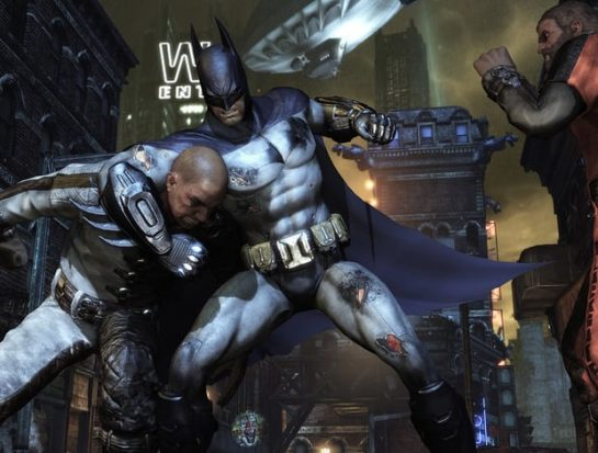 Batman smashing someones head in as it is tucked under his arm, and to the right there is another thug watching. The city is behind them. This is a still from Arkham Knight.