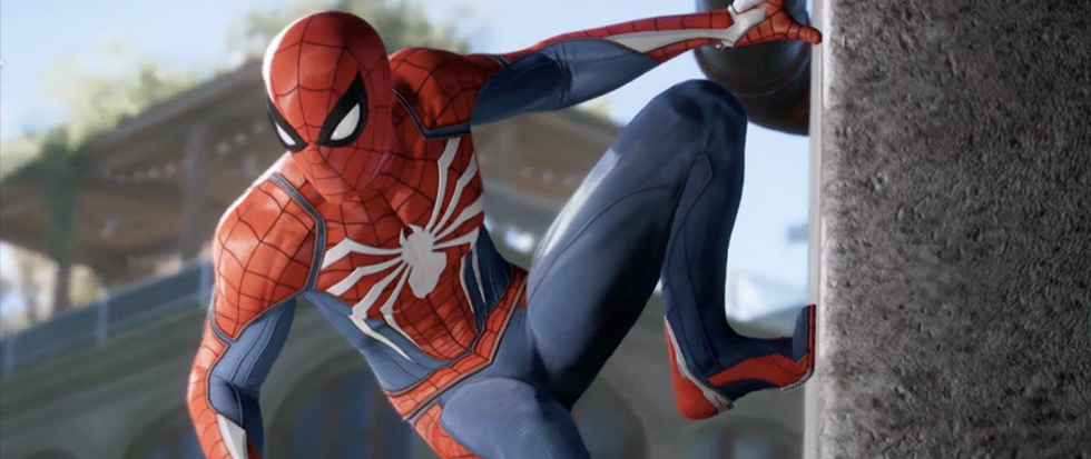 Spider-Man moutned on the side of a wall in a slightly heroic looking pose. This is a promotional image for the 2018 game Spider-Man