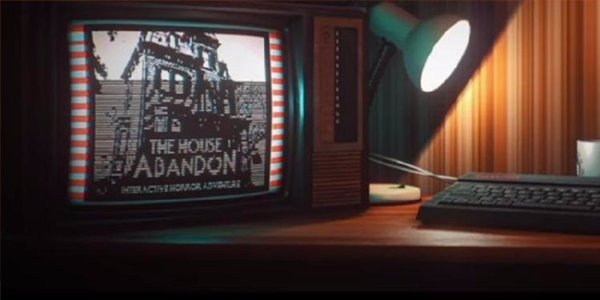 """A computer and a keyboard with a lamp pointed slightly askew. On the screen is the text """"The House abandon"""" alongside a pixelated image of a haunted house. This is a screenshot from the game Stories Untold"""