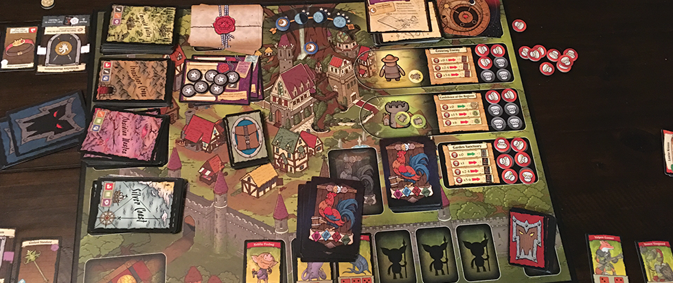 A table top all set up with the board game By Order of the Queen.