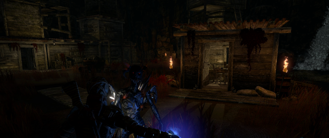 A bright blue demonic figure standing next to a burst of blue light with a wooden cabin in the background.