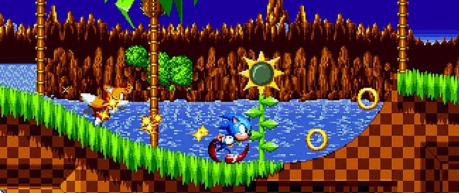 Sonic, his legs a circle of red below him, runs along a green rolling hill in a pixel art style. This is a screen from Sonic Mania.