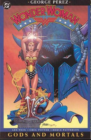 Wonder Woman, in her star spangled uniform with her sword glittering and raised high, stands in front of a large blue helmet on this, the cover of Wonder Woman Gods and Monsters.