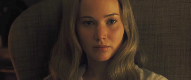 Jennifer Lawrence, long blonde hair hanging around her face, stares directly to camera in this still from mother!