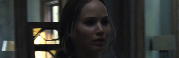 Jennifer Lawrence center screen stares to the right in what I guess is dread. This is a still from the mother! trailer