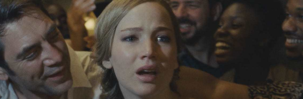 Jennifer Lawrence, surrounded by people who are alight with adulation, looks horrified. This is a still from mother!