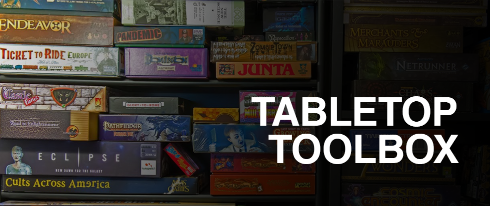 "A collection of tabletop games, with the text ""tabletop toolbox"" in big white letters in the foreground."