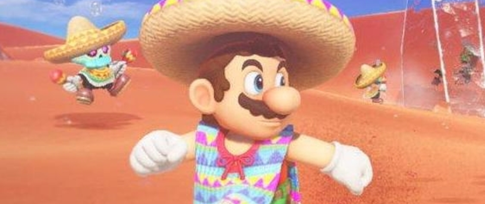 Mario in a rainbow poncho and sombrero, running away from something to the right.