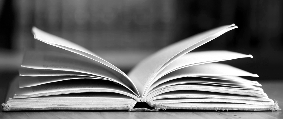 A black and white image of an open book.