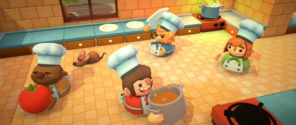 A few cartoon chefs running around haphazardly in an orange tile kitchen. This is a still from overcooked.