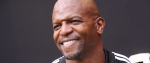 Smiling, actor Terry Crews looks to the left.