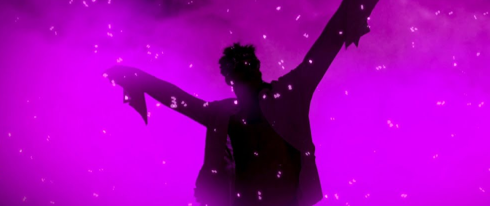 A purple silhouette against a lighter purple background. This is the silhouette of wrestler Velveteen Dream