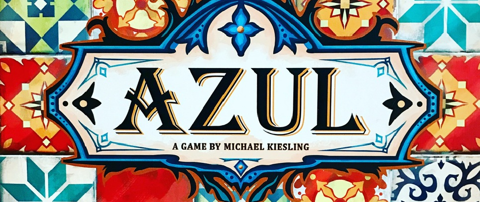 "A set of brightly colored tiles with a logo in the middle that reads ""Azul"""