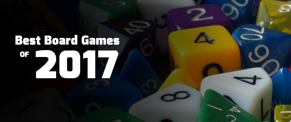 "A pile of assorted tabletop dice with text over that reads ""best board games of 2017"""
