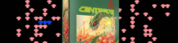The green box for Centipede on top of an actual game of arcade Centipede