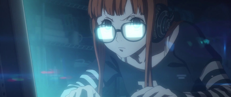 A woman with long red hair types excitedly on a keyboard, the white screen reflected in the glasses.