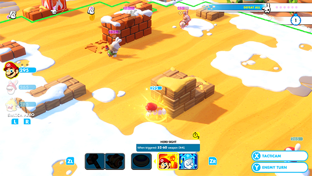 A yellow playfrield with snow on the edges. Thi sis a still from Mario vs. Rabbids.