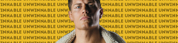 A strong jawed man looks towards camera (this is Cody Rhodes) while wearing a shearling coat. he is bare chested.