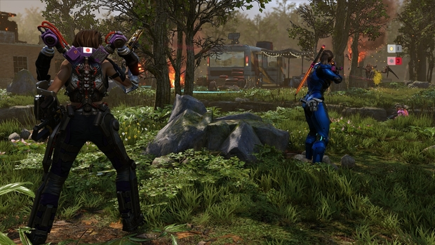 Soldiers stand in a green area. This is a still from XCOM 2