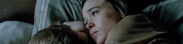 Ellen page is browns, looking sad, lays in a bed cradling a small boy to her chest.