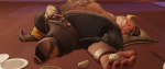 an overweight hog faced creature lays prone on the ground, a dumpling in its hand.