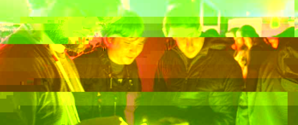 A glitched out yellow and orange image of three men playing