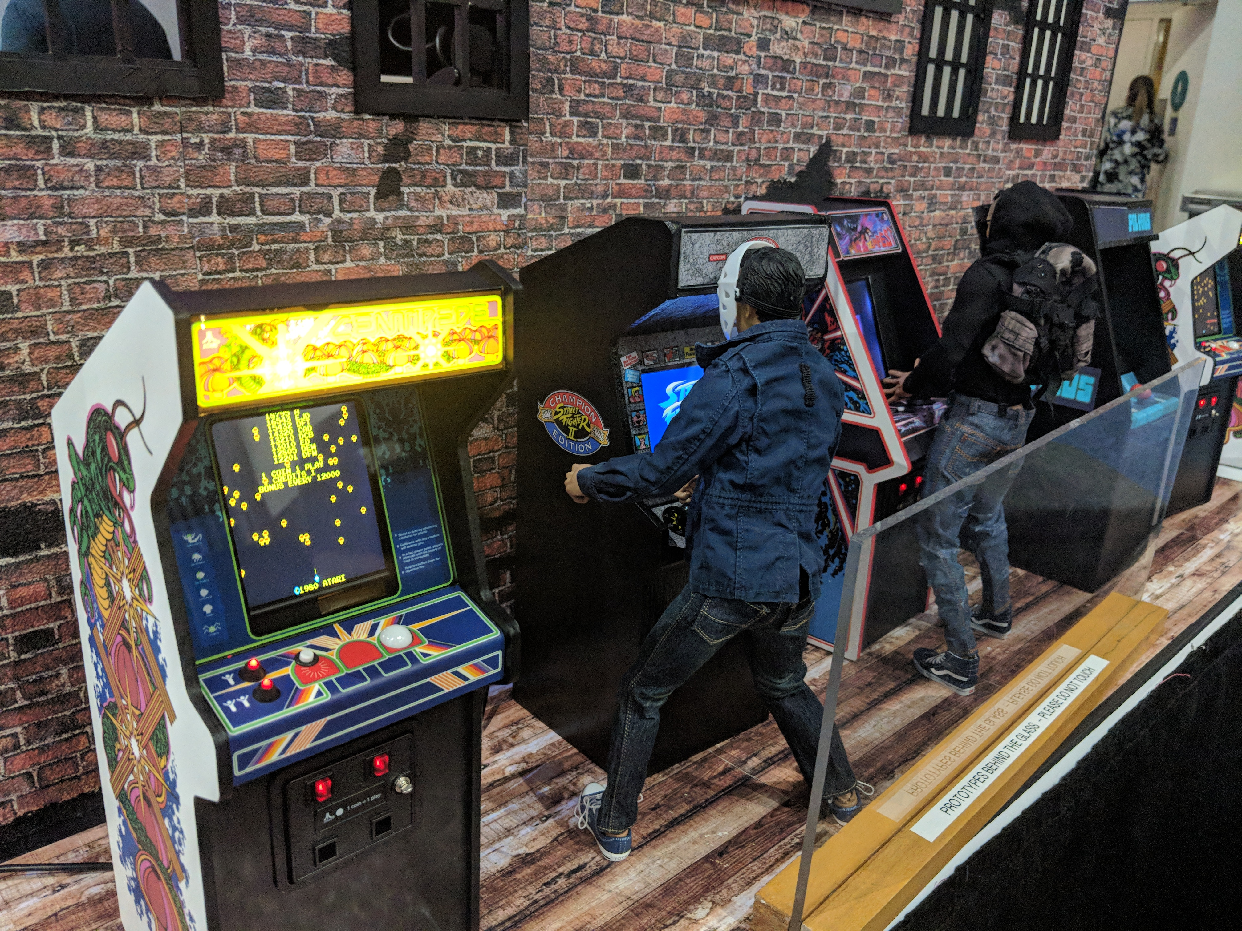Attendees of E3 2018 play classic arcade machines.