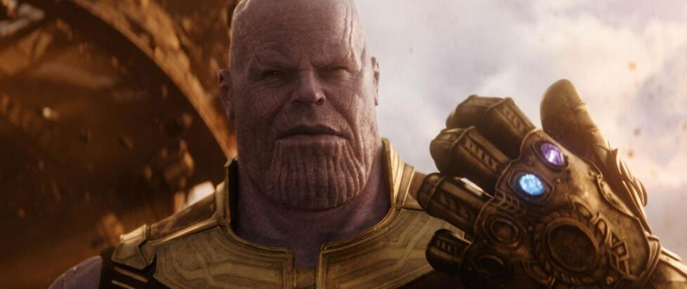 The main antagonist from Avengers: Infinity War, Thanos, holds the Infinity Gauntlet.