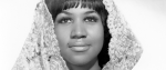 a young Aretha Franklin, her face beautific, hair covered in a lace shawl.