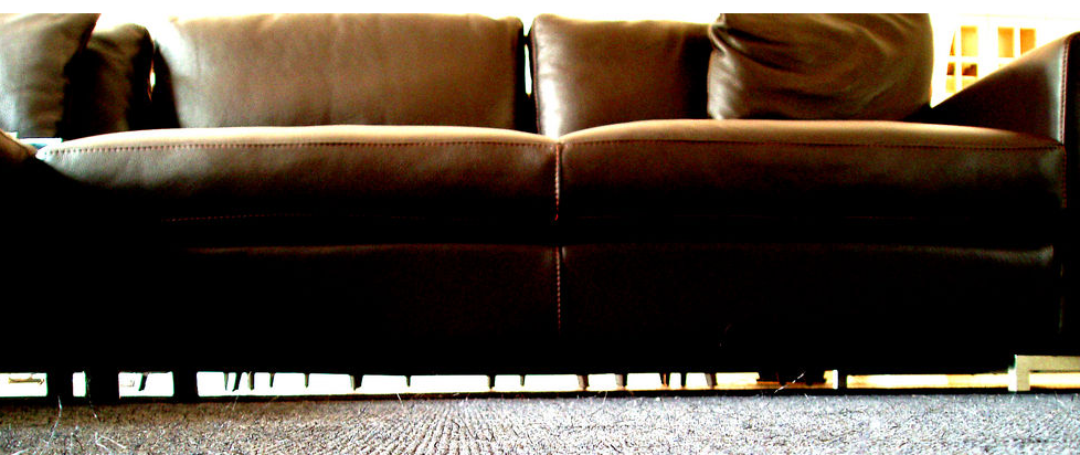 A dark brown couch, shot from below.