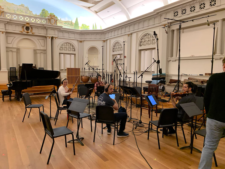 Videri String Quartet sitting among recording equipment,