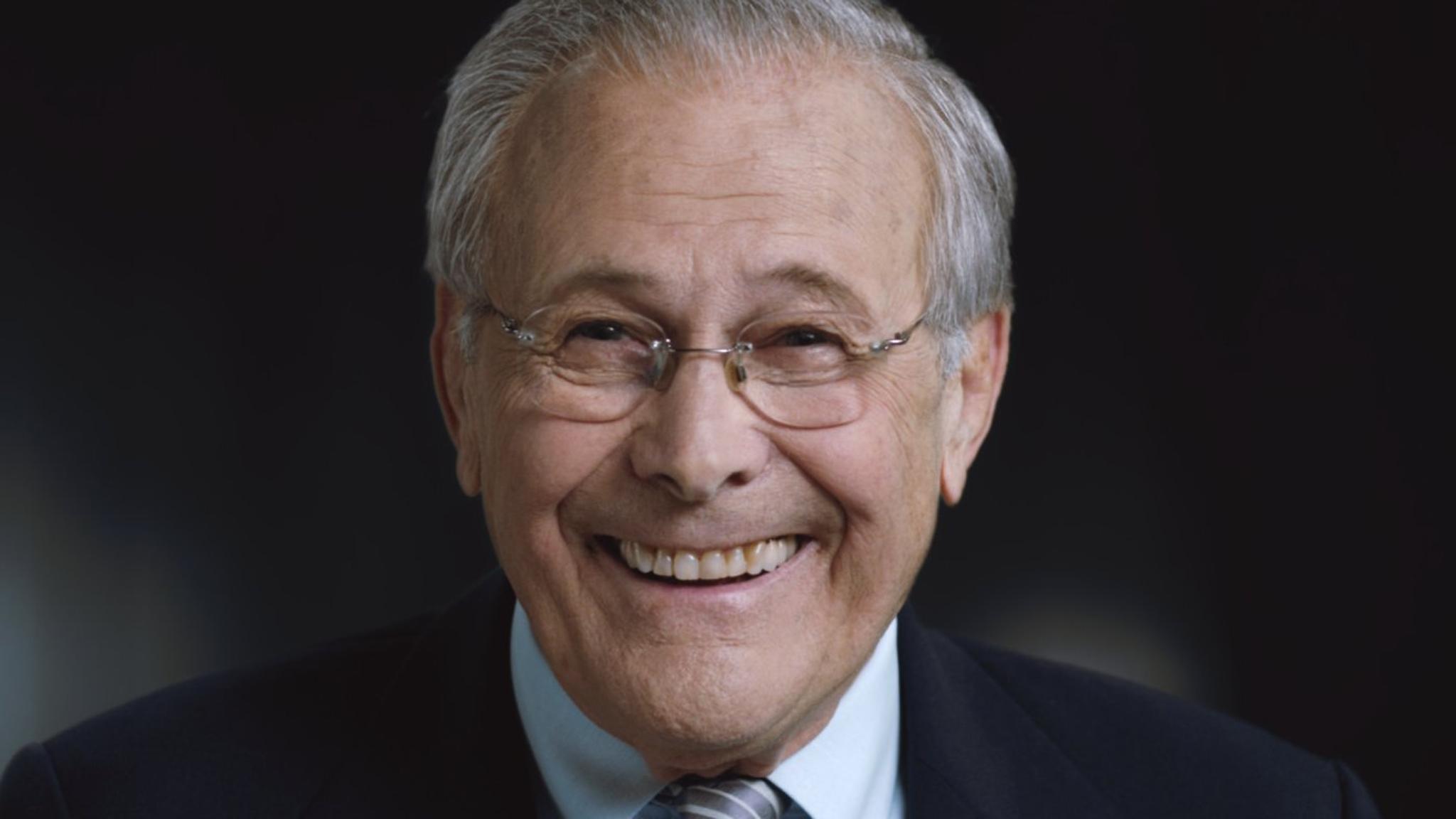 Donald Rumsfeld smiling.