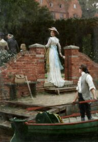 A woman looks out in a brick area of an English garden.