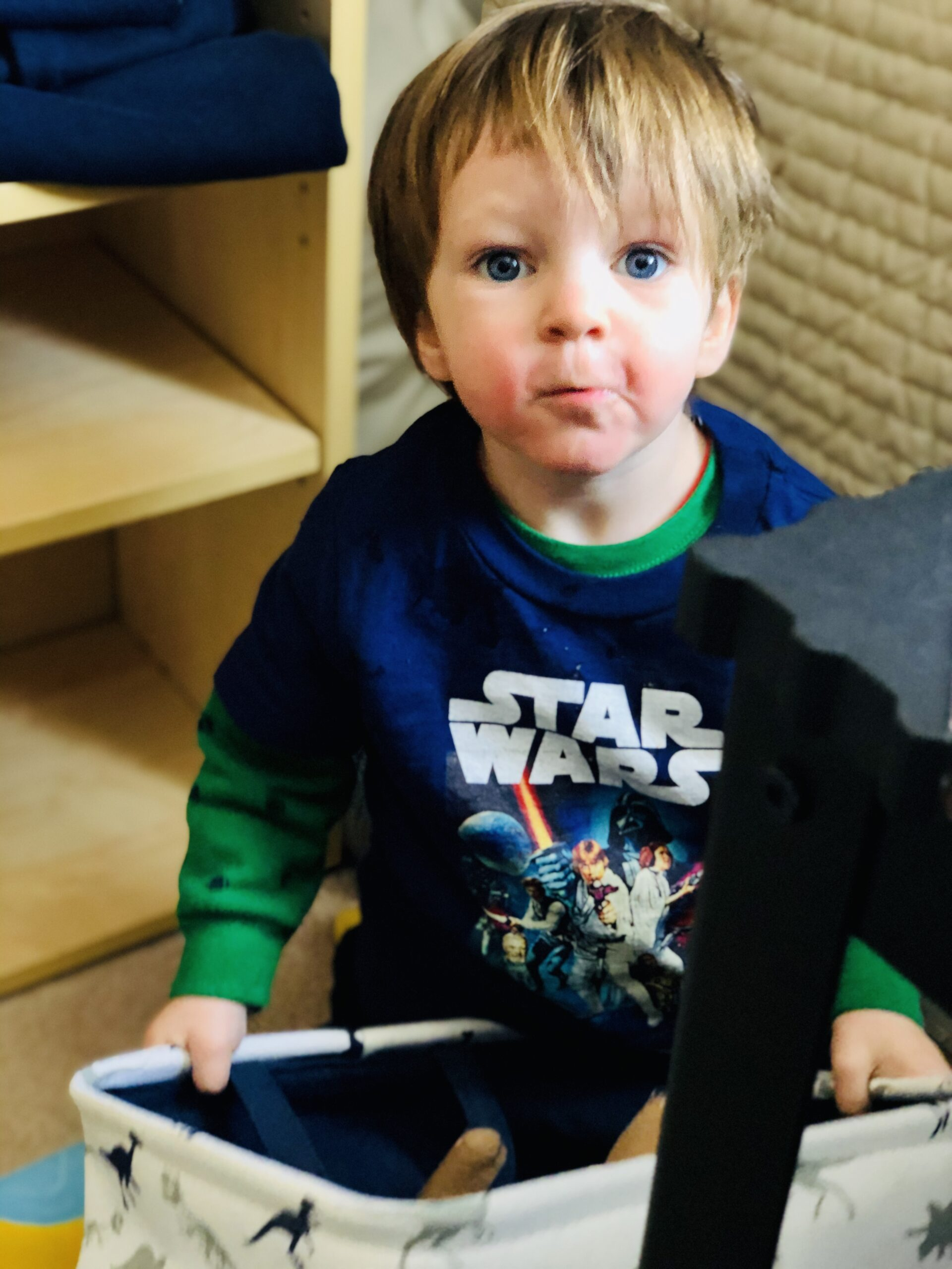 A young boy wearing a Star Wars shirt.