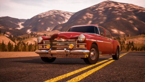 A red classic car in the American post-war style.