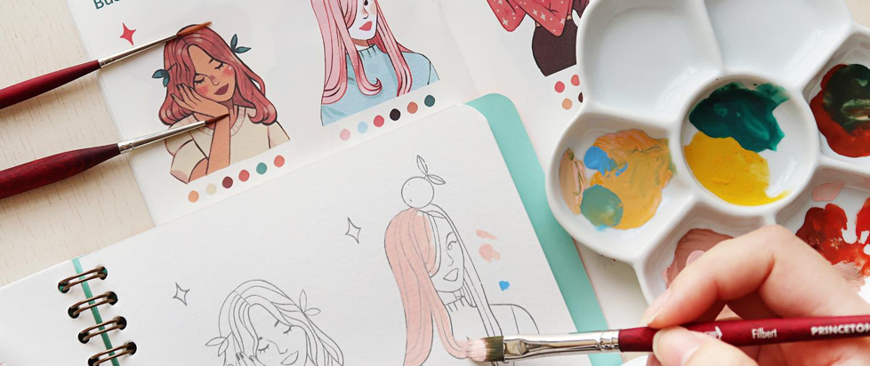 An image of a white persons hand holding a brush as it paints a workbook in gouache. This is a still from this: https://www.mossery.co/products/sibylline-meynet-gouache-art-kit