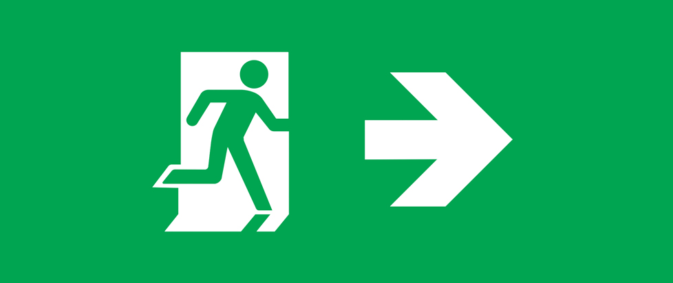 A green and white exit sign.