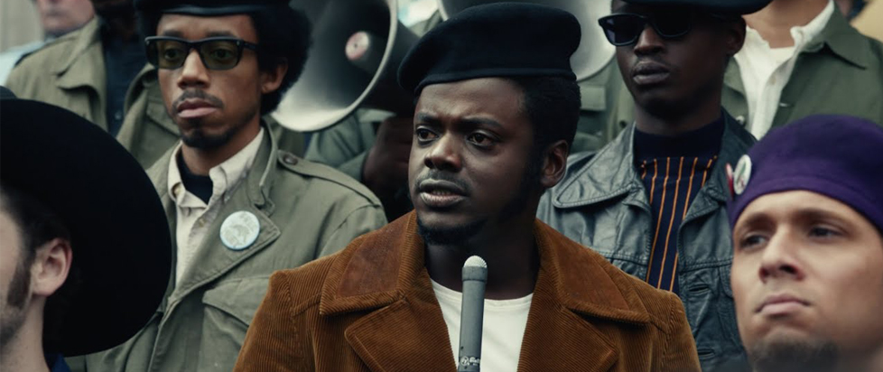 Daniel Kaluuya as Fred Hampton speaks to a crowd.