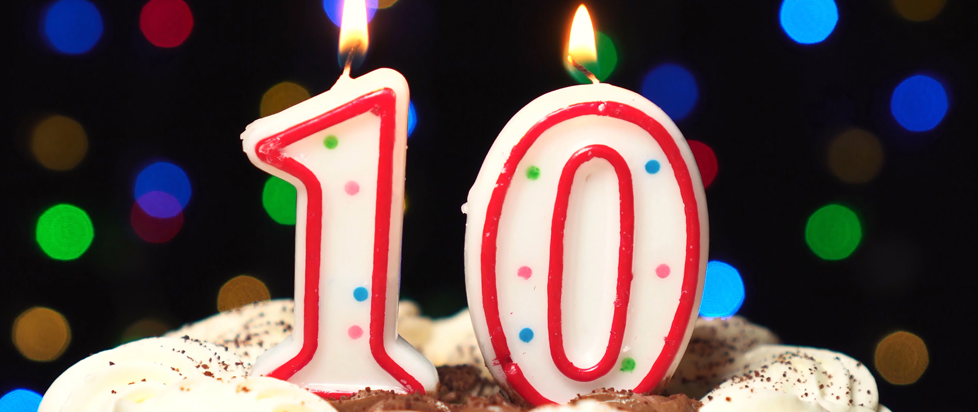 A birthday cake with candles that say 10.