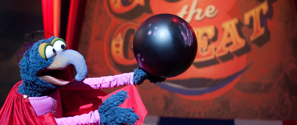 Gonzo from the Muppets holding a cannonball.