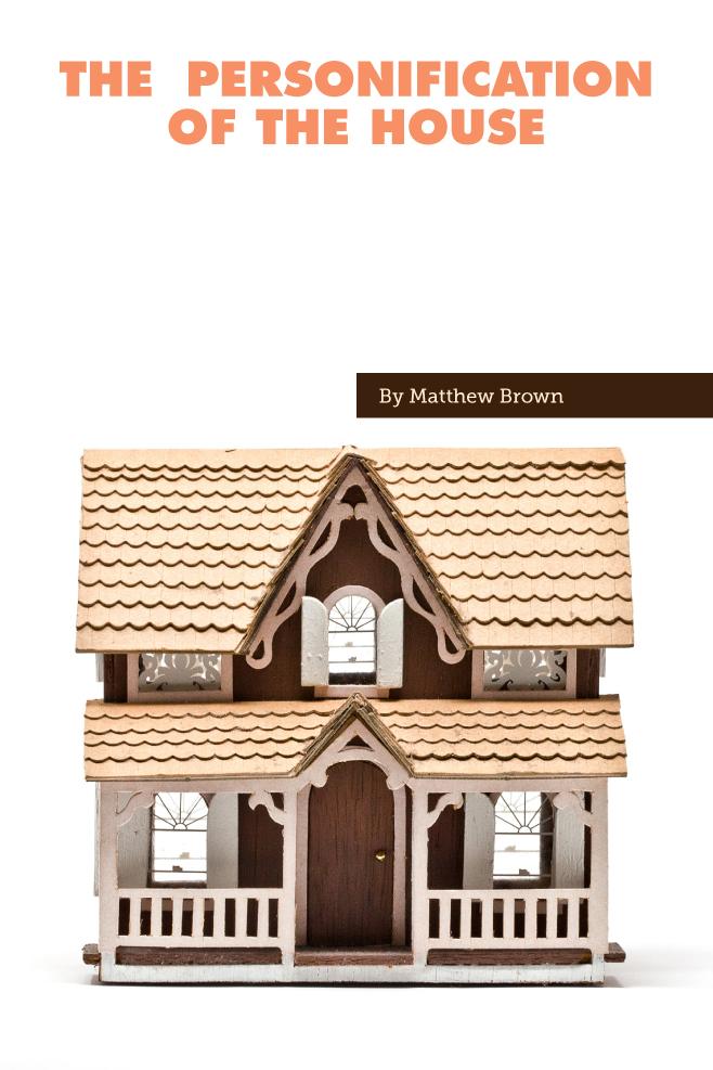 A photo of a small model tan and brown home.