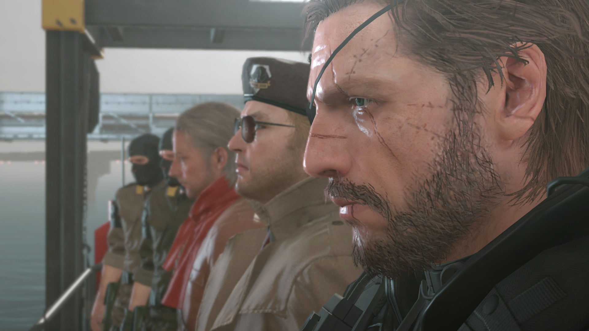 Snake, Kaz Miller, and Ocelot standing with others.